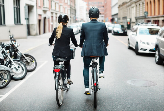 couple riding bikes next to eachother