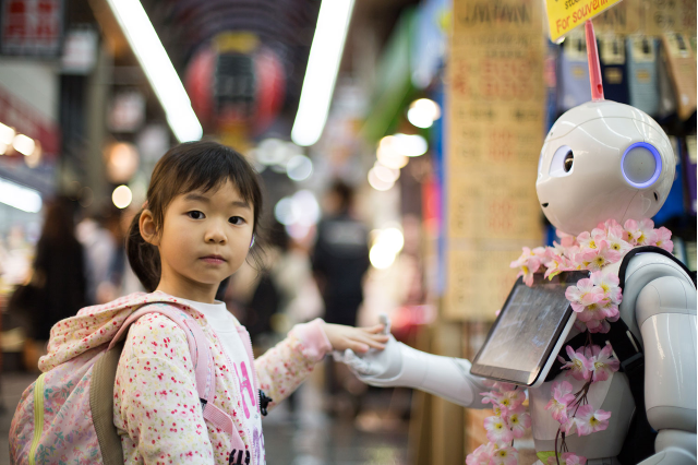 girl shaking hand with robot